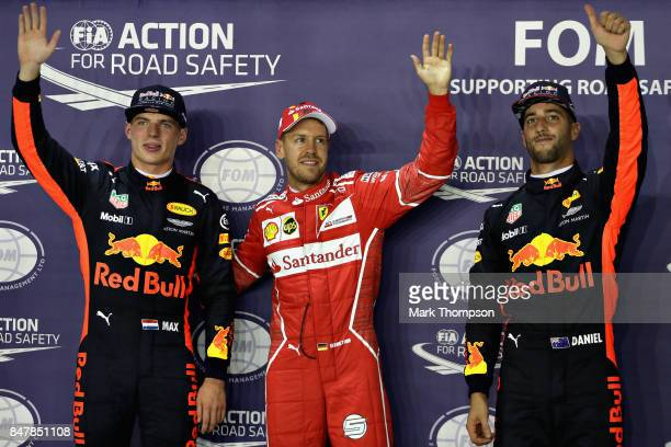 Top three qualifiers Sebastian Vettel of Germany and Ferrari Max Verstappen of Netherlands and Red Bull Racing and Daniel Ricciardo of Australia and...
