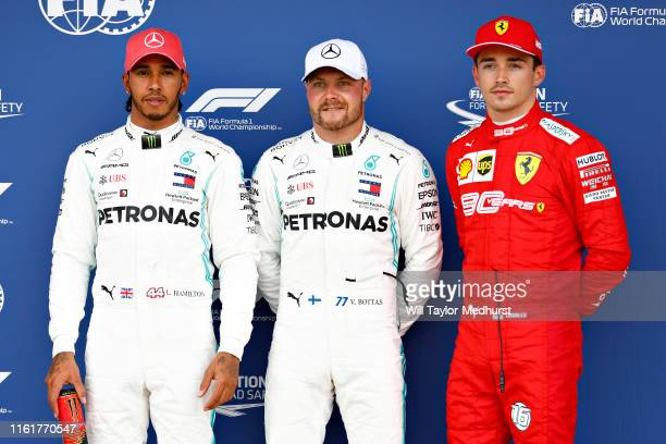 Top three qualifiers Valtteri Bottas of Finland and Mercedes GP Lewis Hamilton of Great Britain and Mercedes GP and Charles Leclerc of Monaco and...