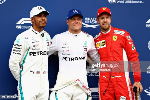 Top three qualifiers Valtteri Bottas of Finland and Mercedes GP Lewis Hamilton of Great Britain and Mercedes GP and Sebastian Vettel of Germany and...