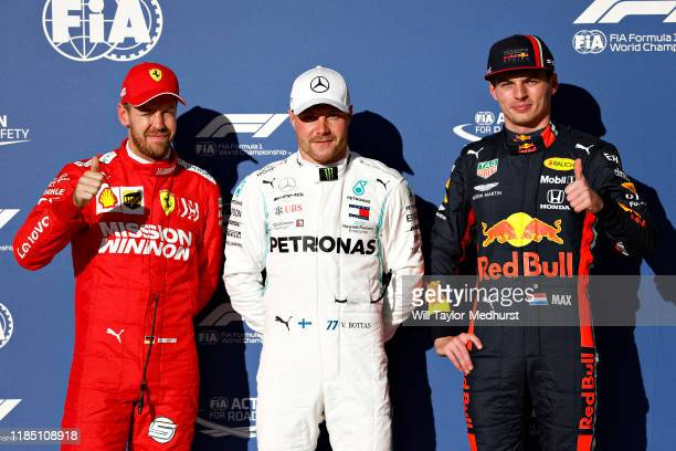 Top three qualifiers Valtteri Bottas of Finland and Mercedes GP, Sebastian Vettel of Germany and Ferrari and Max Verstappen of Netherlands and Red...