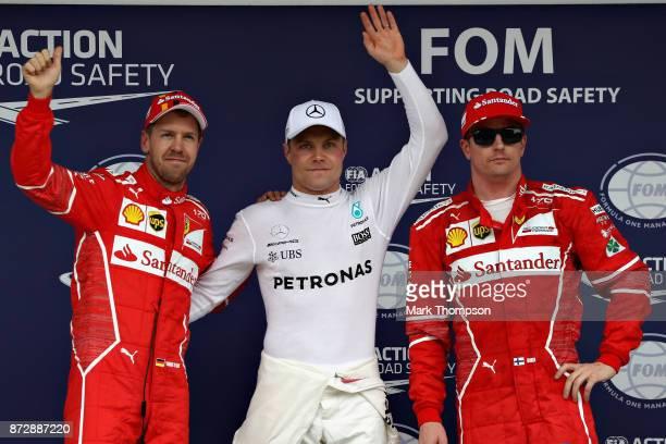 Top three qualifiers Valtteri Bottas of Finland and Mercedes GP Sebastian Vettel of Germany and Ferrari and Kimi Raikkonen of Finland and Ferrari...