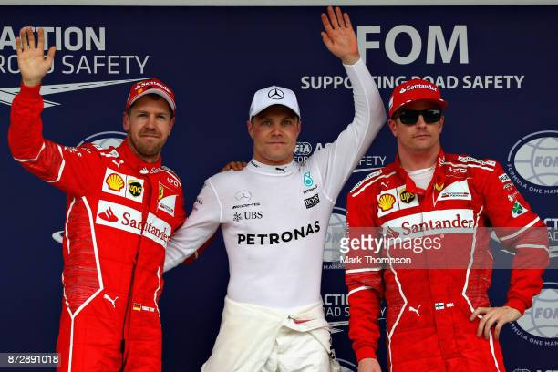 Top three qualifiers Valtteri Bottas of Finland and Mercedes GP Sebastian Vettel of Germany and Ferrari and Kimi Raikkonen of Finland and Ferrari...