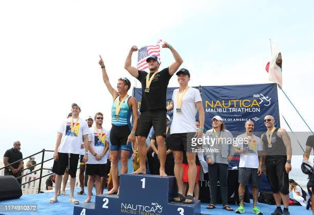 Top triathlon performers onstage during the post race ceremony at the 33rd Annual Nautica Malibu Triathlon Presented By Bank Of America on September...