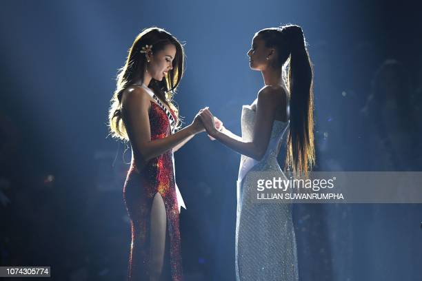 TOPSHOT Top two finalists Catriona Gray of the Philippines and Tamaryn Green of South Africa hold hands while waiting for the announcement of the...