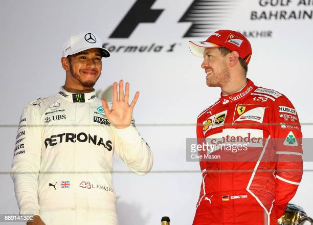 Top two finishers race winner Sebastian Vettel of Germany and Ferrari and second placed Lewis Hamilton of Great Britain and Mercedes GP on the podium...