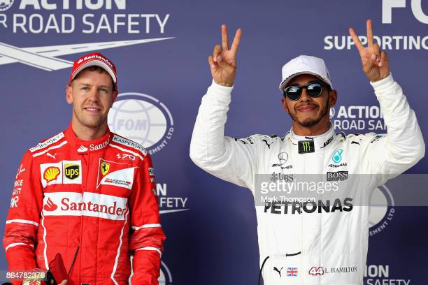 Top two qualifiers Lewis Hamilton of Great Britain and Mercedes GP and Sebastian Vettel of Germany and Ferrari in parc ferme during qualifying for...