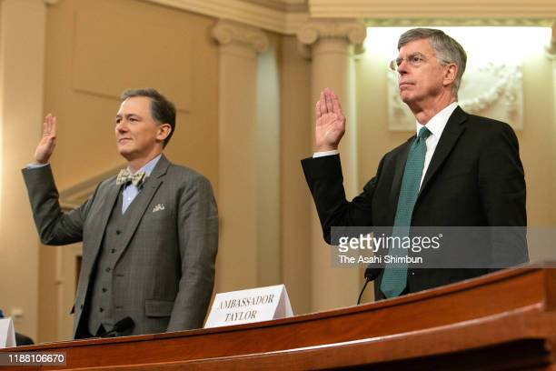 Top US diplomat in Ukraine William B Taylor and Deputy Assistant Secretary for European and Eurasian Affairs George P Kent are sworn in before...