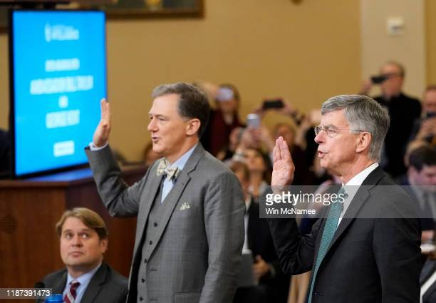 Top US diplomat to Ukraine William B Taylor Jr and Deputy Assistant Secretary for European and Eurasian Affairs George P Kent are sworn in prior to...