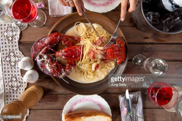 top view a delicious freshly boiled lobster for dinner set wood table background - lobster stock pictures, royalty-free photos & images