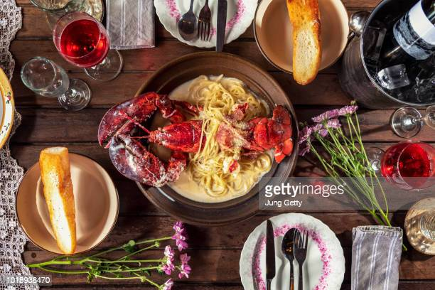 top view a delicious freshly boiled lobster for dinner set wood table background - red lobster restaurant stock pictures, royalty-free photos & images