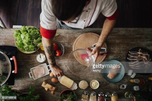 top view at chef who starts to prepare a meal for dinner - chef stock pictures, royalty-free photos & images