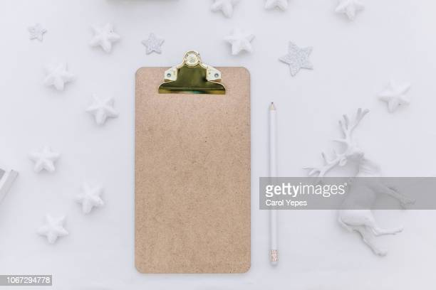 top view blank clipboard and xmas ornaments - clipboard stock pictures, royalty-free photos & images