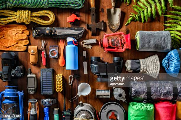 top view camping and hiking travel and hiking gear, equipment and accessories for mountain trips - equipment stock pictures, royalty-free photos & images