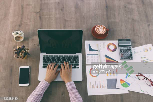 top view closeup hands using laptop
