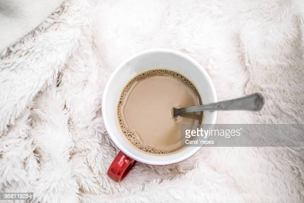 top view coffee milk cup with cozy blanket.Winter concept