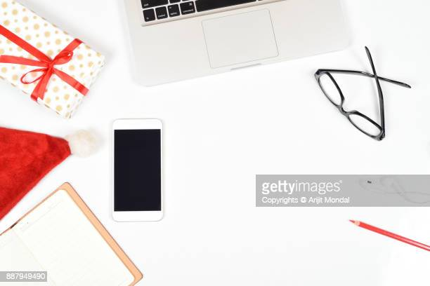 Top view computer and phone for business concept with Christmas festival theme, white background copy space