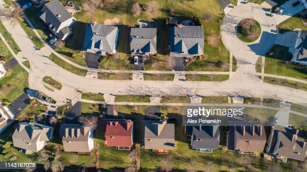 top view directly above drone aerial view of the street in the residential neighborhood libertyville, vernon hills, chicago, illinois. - chicago illinois stock pictures, royalty-free photos & images