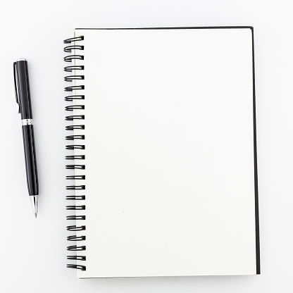 Top view, empty notebook on a white background. 1141585821