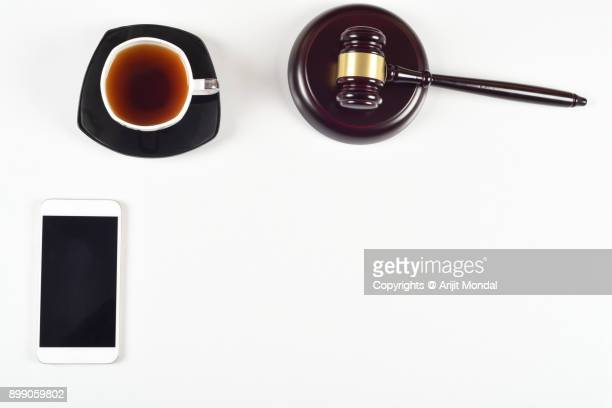 Top view, flat lay close up legal concept on a white background justice and law concept with smart phone copy space for text