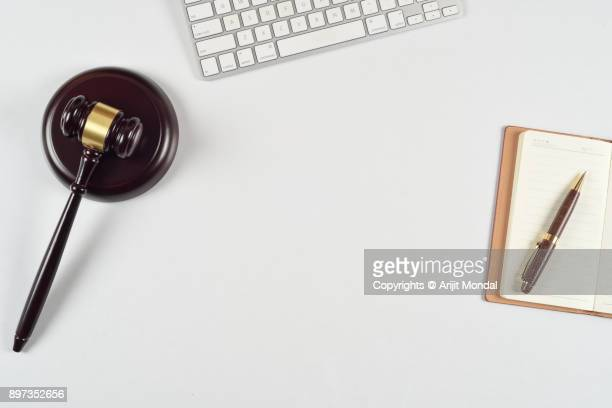Top view flat lay modern lawyer office desk with Gavel and sound block, computer keyboard