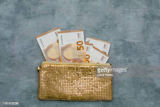 top view golden purse with 50 euro bill - gold purse stock pictures, royalty-free photos & images