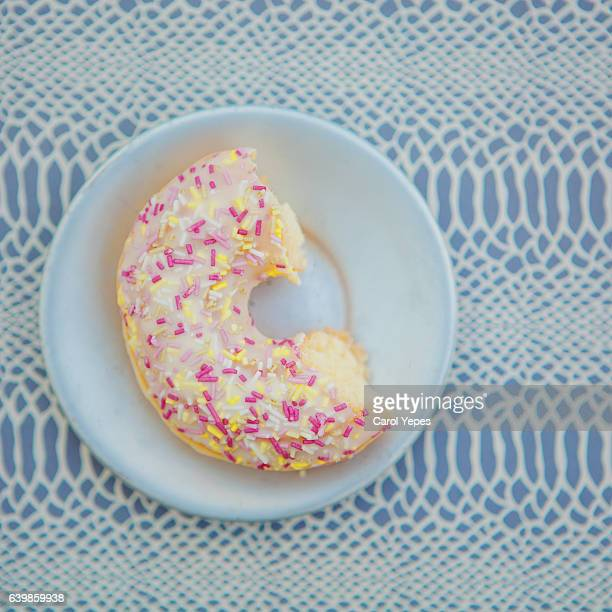 top view half donuts in a plate