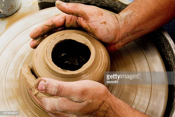 a top view image of two hands molding clay - loam stock photos and pictures
