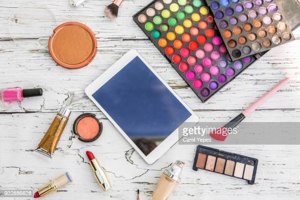 top view makeup and digital tablet