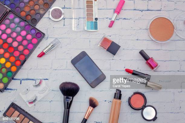 top view makeup and smartphone