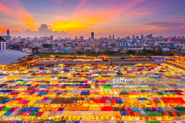top view multiple colour market rooftop night market at twilight - capital cities stock pictures, royalty-free photos & images