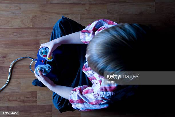 Top view of a boy playing video games