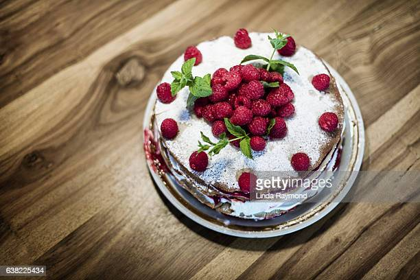Top view of a cake with raspberries on the top