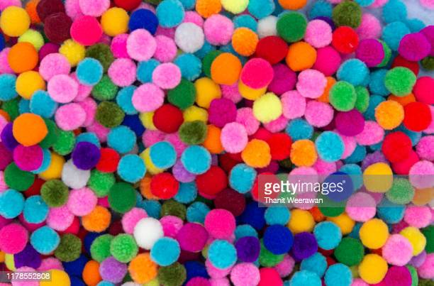 top view of a colorful pom pom background - animal hair stock pictures, royalty-free photos & images
