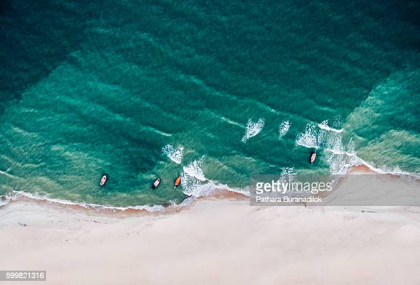 Top view of a fishing boat at the beach