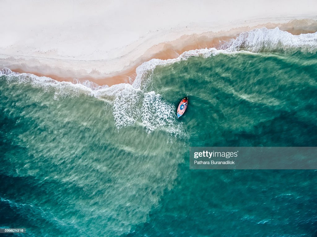 Top view of a fishing boat at the beach : Stock Photo