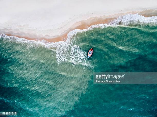 top view of a fishing boat at the beach - indian ocean stock pictures, royalty-free photos & images