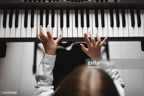 top view of a girl playing synthesizer - ピアノの鍵盤 ストックフォトと画像