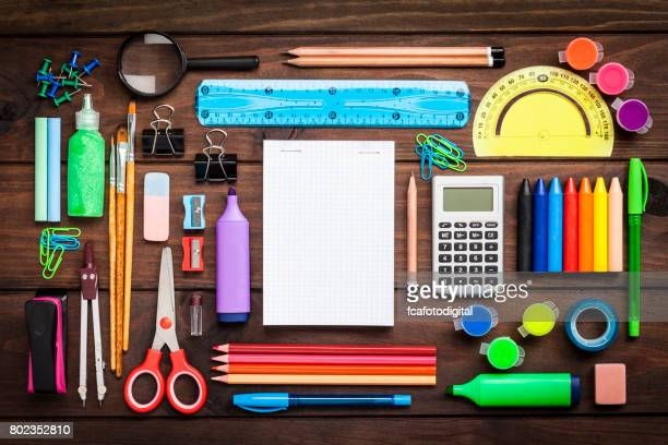 top view of a large group of school or office supplies on wooden table - art and craft equipment stock pictures, royalty-free photos & images