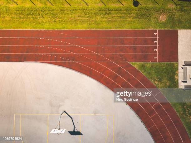 top view of a numbered running tracks at sports athletic stadium - track and field stadium stock pictures, royalty-free photos & images