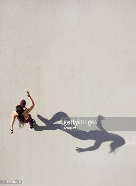 top view of a woman running with copy space. - women's track stock pictures, royalty-free photos & images