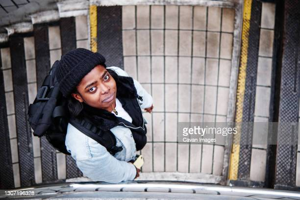 top view of a women looking at camera - embellished jacket stock pictures, royalty-free photos & images