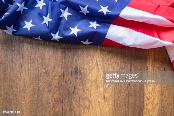 top view of american flag on wooden background with copy space for text. - 4th stock pictures, royalty-free photos & images
