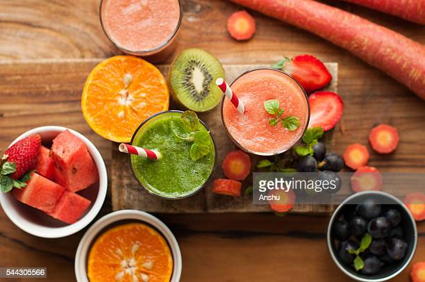 Top view of assorted Fruit Juice  like watermelon, green juice on a wooden background
