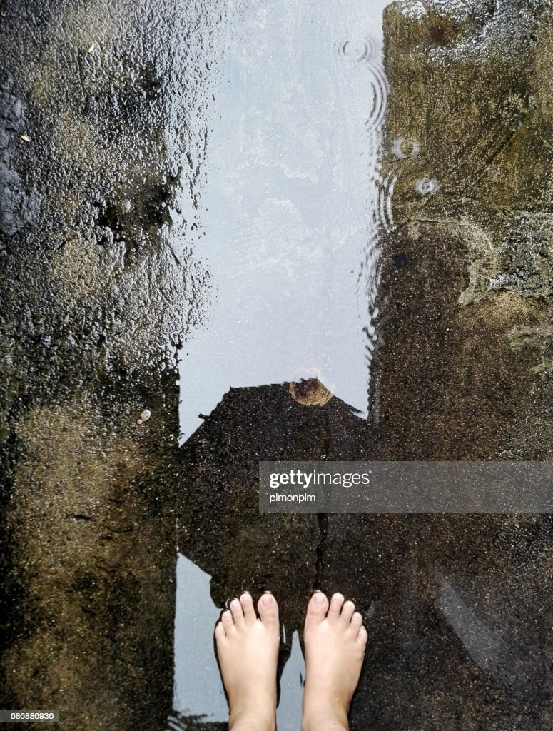 Top View Of Bare Foot On Cement Floor Stock Photo