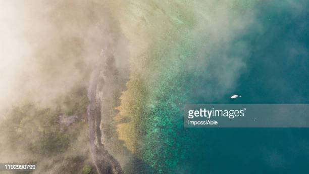 top view of beach near phi phi don island with the misty in the morning, andaman sea , krabi, thailand - impossiable stock pictures, royalty-free photos & images