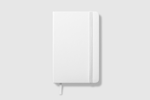 Top view of Blank photorealistic notebook mockup on light grey background. 1137328224