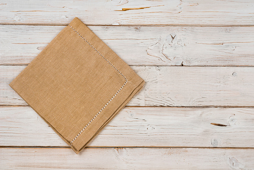 Top view of brown kitchen napkin on wooden planks background 618331650