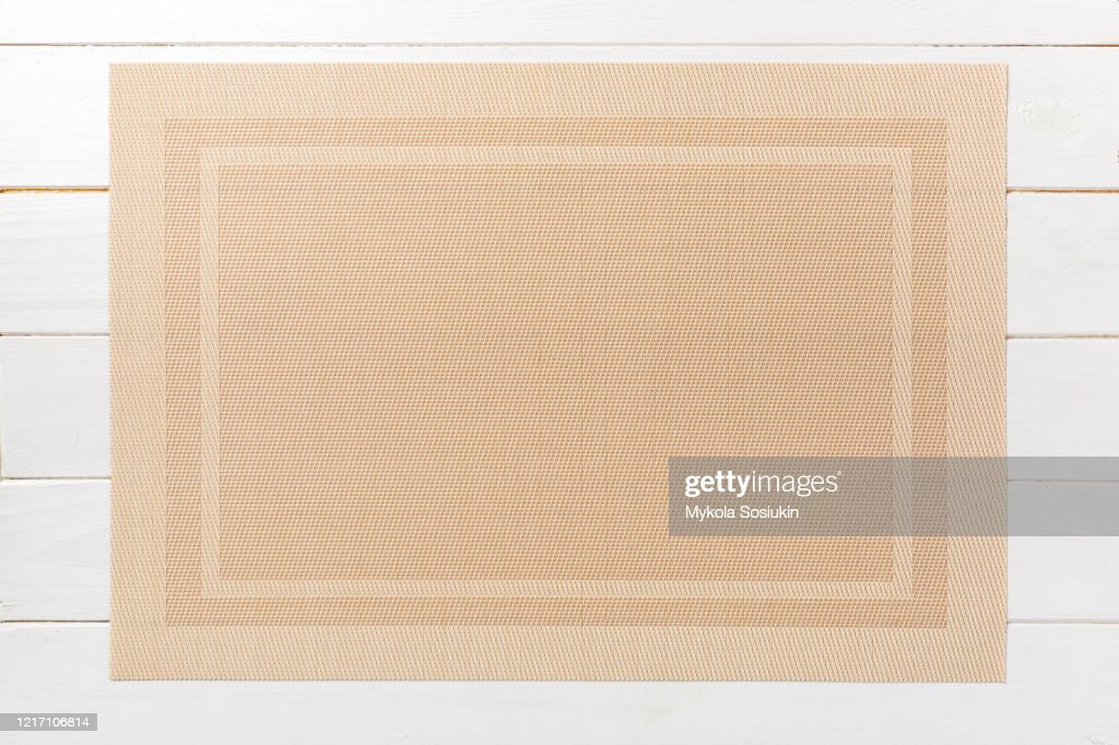 Top view of brown place mat for a dish. Wooden background with empty space for your design : Stock Photo