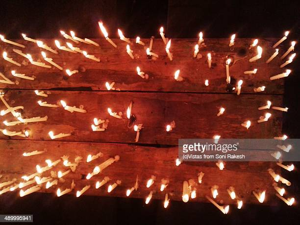 Top view of burning candles atop a table