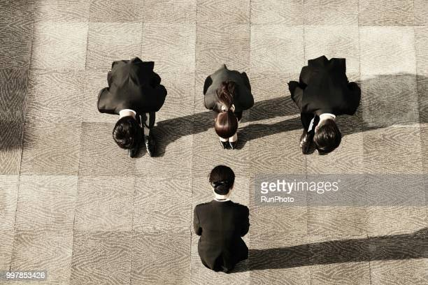 top view of business people bowing - お辞儀 ストックフォトと画像